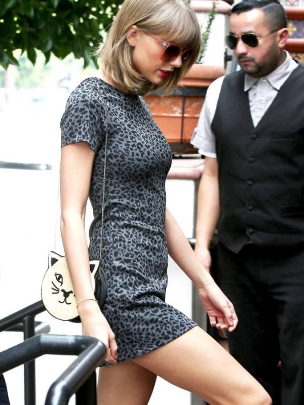 Taylor-Swift-Teases-In-A-Mini-Dress-06-675x900