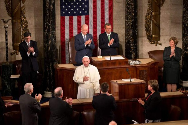 Pope Francis listens to applause before addressing a joint meeting of Congress on Capitol Hill in Washington, Thursday, Sept. 24, 2015, making history as the first pontiff to do so.  (AP Photo/Alessandra Tarantino)