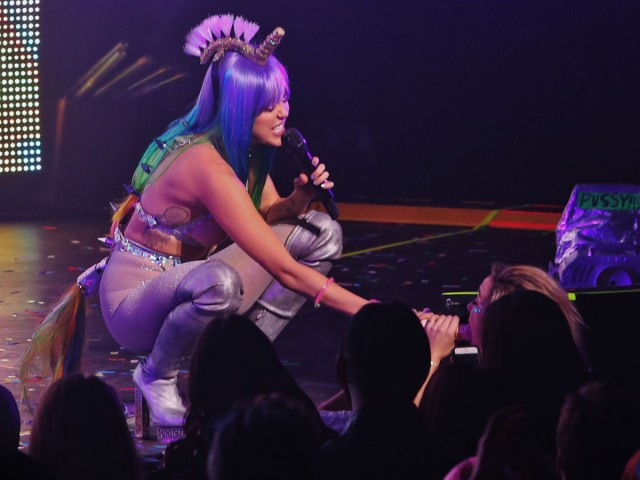 Exclusive... 51931014 Singer Miley Cyrus takes a break from performing live during the 'Miley Cyrus and Her Dead Petz' tour to engage a young fan in Vancouver, Canada on December 14, 2015. Miley handed one of her many sex toy props down to a female fan in the front row who then put it in her mouth!